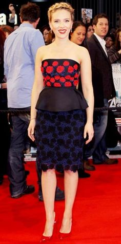 Look of the Day › April 20, 2012  WHAT SHE WORE The actress walked the red carpet at the London premiere of The Avengers in a floral embroidered design from Prada, patent heels and Bulgari diamond earrings. WHY WE LOVE IT Scarlett Johansson played up her shape in curve-enhancing peplum dress.