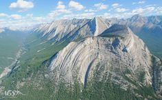 Here we see geologic folds – formations that occur when originally horizontal layers are bent and curved due to (usually) tectonic pressures. For many geologists, folds such as this one are part of their everyday activities. The picture in case was taken at Mt. Head.