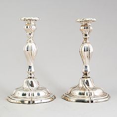 A pair of silver Rococo style candlesticks with Swedish import marks, first half of the 20th Century. - Bukowskis