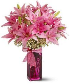 6 multibuds Asiatic Lilliums put in a glass vase.