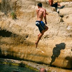 Jumping into the waterfalls at Ein Gedi