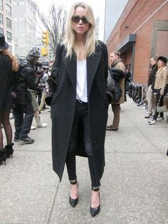 Elin Kling in a big black coat