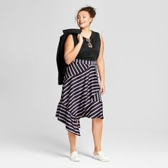 With a flowy silhouette and timeless pattern, the Striped Asymmetrical Skirt from A New Day™ will become a quick favorite in your wardrobe. Vertical, horizontal and diagonal stripes give interesting dimension and appeal to this mid-rise midi skirt, while the satin construction makes for a comfortable fit for all-day wear. Easily dressing up or down for a variety of styling options, you'll love pairing it with a tucked-in T-shirt and and canvas sneakers for a casual outing, and th...