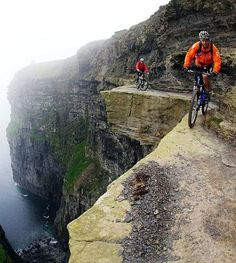 dangerous walking or bike pathway. living on the edge. my heart is racing just thinking about that cliff!