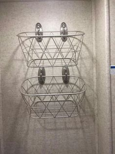 THIS IS FOR CAMPER/RV USE ONLY...  HANG SOME COMMAND HOOKS ON THE WALL AND PUT BASKETS ON THEM FOR EXTRA STORAGE FOR ITEMS SUCH AS HAIRDRYER AND HAIRBRUSH AND ETC  MAKE SURE YOU PUT IT ON A WALL THAT GIVES YOU ROOM TO WALK OTHERWISE YOU WILL JUST KNOCK THEM DOWN