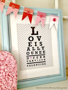 Aqua and Pink Valentine Mantel from herecomesthesunblog.net #valentine #mantel   Love the paint chip banner