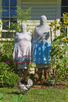 Disturbing Couple...just hanging out in the garden...even their poor chicken is running for his dear life!!