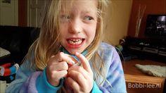 Mijn losse tand gaat steeds meer los zitten.Zou het lukken met een touwt...