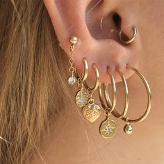 ♕ Gold filled hoop earrings in different sizes and different charms NOTE: Sold individually, NOT as a pair ! ⋆Pick your favorite charm & hoop size. -Diamond star disc - 14K Gold Plated Vermeil -Peace gold disc - 14K Gold Plated Vermeil -Puffy heart - 14K Gold Filled -Geometrical