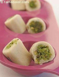 'Kaju Pista Roll' - Cylindrical rolls of cashewnut barfi stuffed with pistachios, By Tarla Dalal Indian Dessert Recipes, Indian Sweets, Indian Snacks, Sweets Recipes, Cooking Recipes, Delicious Desserts, Yummy Food, Yummy Yummy, Diwali Food