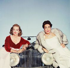 """courtesy original blogger. When Life magazine visited the Baby Jane set, Bette, in the name of vanity, got to compete with Joan. Assisting on the shoot was New York illustrator Joe Eula. """"We needed an old-time but classy background for Bette and Joan,"""" said Eula, """"so we decided to photograph them sitting on the front of a vintage Rolls-Royce. (…)"""