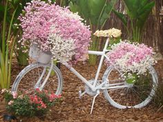 Love the pink and white.  Perhaps some small succulents growing on the seat.  And a large bucket of pinks and whites, and another one tipped over and spilling down the hillside   💐🏵💮💐