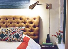 "how to make a tufted headboard using pegboard, 3"" foam and batting."