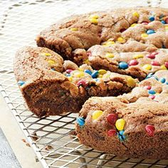 "This recipe, a variation of one in her book Batter Up Kids Delicious Desserts cookbook, is from best-selling cookbook author and kids' cooking expert Barbara Beery, the founder of Batter Up Kids, Inc. ""Kids adore giant cookie 'cakes' for birthday and team sport parties,"" says Barbara. Baking it in a cast iron pan is an easy way to keep the cookie perfectly round.."