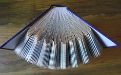 Folded book art scalloped III recycled book door DancingGreyStudio