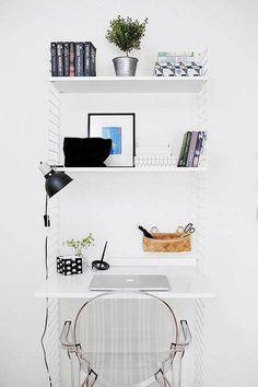 Outfit an angular wall shelf with an extended shelf to utilize as desk space.