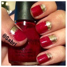A timeless classic: #red! Make it #festive with #gold and #redglitter. #halfmoon #manicure. #nails #uñas #unghie #nailpolish #esmalte #smalto #nailart. #beauty #belleza #bellezza #cosmetics #cosmeticos #cosmetici #fabat40.