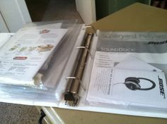 user manuals and receipts in a 3 ring binder