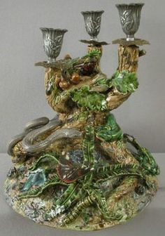 antiques price guide, antiques priceguide, lighting, France, Geoffrey Luff, contemporary majolica Palissy Ware, three light candelabra depicting tree trunk with snake, lizard, frog, flowers, butterfly, fly, ferns, oak leaves, acorns and other plant life.
