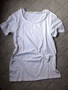 Tutorial on how to change a crew neck t-shirt to scoop neck.