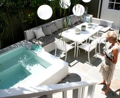 Great outdoor spa- like the idea of a bench AND table. Space saver + more seating on the deck?