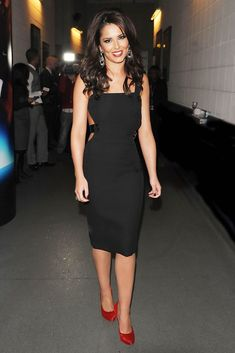 Cheryl puts the edge on the little black dress in a sexy leather strapped