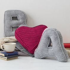 Treat yourself with our colourful crochet letter cushions. They are the perfect gift to suit any home. Your cushions say a lot about you. Make someone's sofa happy with one of these feel-good cushions. They're made from soft, squishy wool mix in a rainbow of colours – everything from soft grey to bright cherry red. From the minimalist living room to a fun children's bedroom. Our wool-mix is soft and top quality. These are chunky, sturdy cushions – perfect for cuddling up with on a night in…