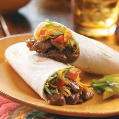 """Steak Tortillas Recipe -""""When I fix steak, I always grill one extra so I have leftovers to make these delicious filled tortillas,"""" informs Kris Wells of Hereford, Arizona. The steak strips are seasoned with salsa, chili powder and cumin, then tucked inside soft flour tortillas with tasty toppings."""