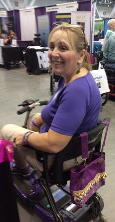 Her scooter has very limited options for adding storage, but the Demi-Premier Mulberry Criss Cross had no problems becoming her new favorite bag! (2015 Boston Abilities Expo)