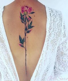 his watercolor peony tattoo is like nothing I've ever seen before. I love how the stem takes up almost the whole length of her spine.