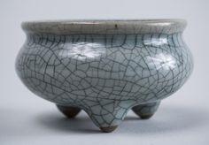 Chinese Stoneware Footed Bowl. Greenish blue crackle glaze, everted rim, bombe body on three feet.