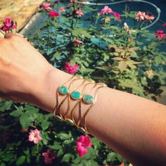 The soft colours of this cuff by Halleh Jewelry works perfectly for a leisurely jardin stroll.  #LoveGold #Wanderlust