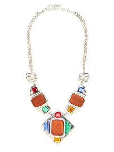 Go bold and audaciously beautiful in this statement necklace, which works both a tribal vibe and cool Art Deco graphics. Plus, we love the hybrid of crafty-chic and all-out glam seen in that combo of wood and crystal gem work.