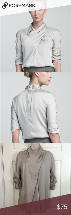 Armani Collezioni Grey Crisscross Satin Blouse This Armani Collezioni blouse is the perfect finishing touch to your favorite collection suits. Almond stretch satin. Crisscross neckline buttons behind neck. Scrunched half sleeves. Relaxed silhouette. Silk/spandex. Armani Collezioni Tops Blouses