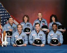 "Challenger flight 51-l crew. Back row (L-R): Ellison Onizuka, Christa McAuliffe, Gregory Jarvis, Judith Resnik. Front row (L-R): Michael J. Smith, Francis ""Dick"" Scobee, Ronald McNair. Challenger broke up 73 seconds after launch on January 28, 1986. There were no survivors."