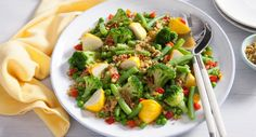 Packed with vegies, this vibrant Spring Greens with Button Squash dish comes together in less than 10 minutes!   #vegetarian #salad #recipe