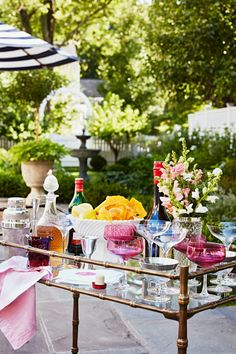 Bar carts serve as stylish yet hardworking hubs for entertaining. Learn how to style your beverage station with these beautiful bar cart ideas. #barcart #barcartstyling #barcartideas #barcartdecor #bhg Outdoor Bar Cart, Summer Party Decorations, Vintage Bar Carts, Bar Cart Decor, Champagne Buckets, Silver Trays, Black Table Lamps, Decorating Blogs, Summer Decorating