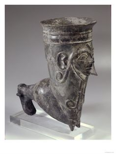 Bucchero Vessel in the Form of a Leg with Sculpted Face, Etruscan Period