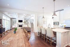 Open concept kitchen living dining. Love the room except I would have stools at the island instead of chairs.