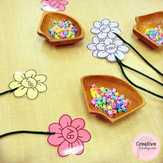 Pattern flowers with beads. Hands-on math center for kindergarten students.