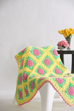 It's just not spring without some bright floral motifs, and this throw has them in spades. This throw is great to work on while on the go as it's made as individual granny squares that are later joined together.