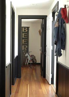 Black trim  doors in a hallway in Susan and Jerry Lauren's Connecticut home