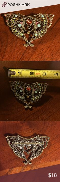 """Jeweled Butterfly Brooch Beautiful jeweled butterfly brooch. Measures 3"""" across and about 2"""" tall. Jewel colors include mint green, pink, and burnt orange. Jewelry Brooches"""