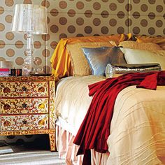 Recognize these boho-chic dots? Yup, this is Serena Vanderwoodsen's bedroom from, Gossip Girl. Designer, Loren Weeks, sparked about a million design trends with this space. Now this is a fabric headboard, but the look can be achieved with a metallic polkadot wallpaper in a snap.