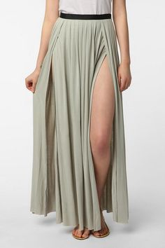 "Ecote Double Slit Maxi Skirt  #UrbanOutfitters* Sleek, cascading maxi skirt from Ecote with double high slits  * Soft and stretchy jersey construction; pleated at the waist  * Super high, wrap-style slits at either side  * Banded waist; hidden zip at the side; raw-edged hem  * Model is wearing size 6  * Measurements taken from size 6  * Waist: 30""  * Length: 43.25""l from waist to hem  Rayon, Spandex"