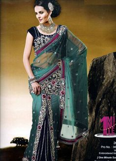 Trendy and comfortable ready to wear saree in designer collection will definetly give you the style statement. This is Deep Green Net, Velvet One Minute Saree with BlouseDesigner patli on skirt of cutwork border looks astonishing. It has Velvet Embroidered blouse. The unstitched matching blouse material can be customised as per the requirement limited to availability of material. Available blouse material length is 80 cm.