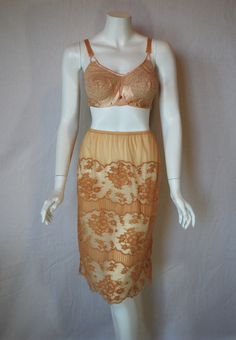 This bra and that slip.  1940s Gossard bra paired with a 1950s Vanity fair gold lace half slip.