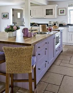 Love the purple cabinets