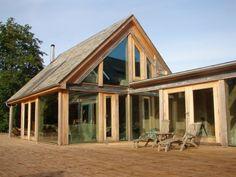 .Stone barn conversion with glazed oak addition/Roderick James Architects