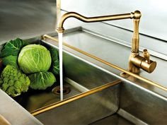 brass and stainless sink and faucet combination from Officine gullo